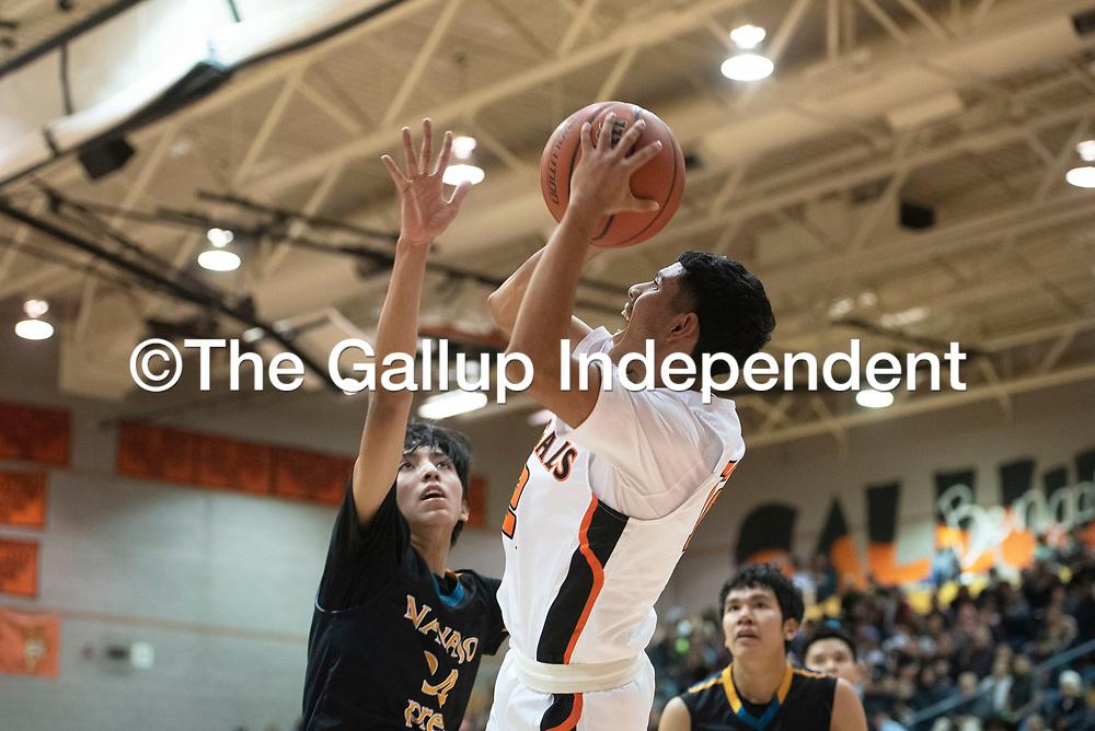Gallup's Isaac Bustinza (12) takes a shot against Navajo Prep Thursday, Jan. 2 at the Gallup Invitational boys basketball tournament at Gallup High School.