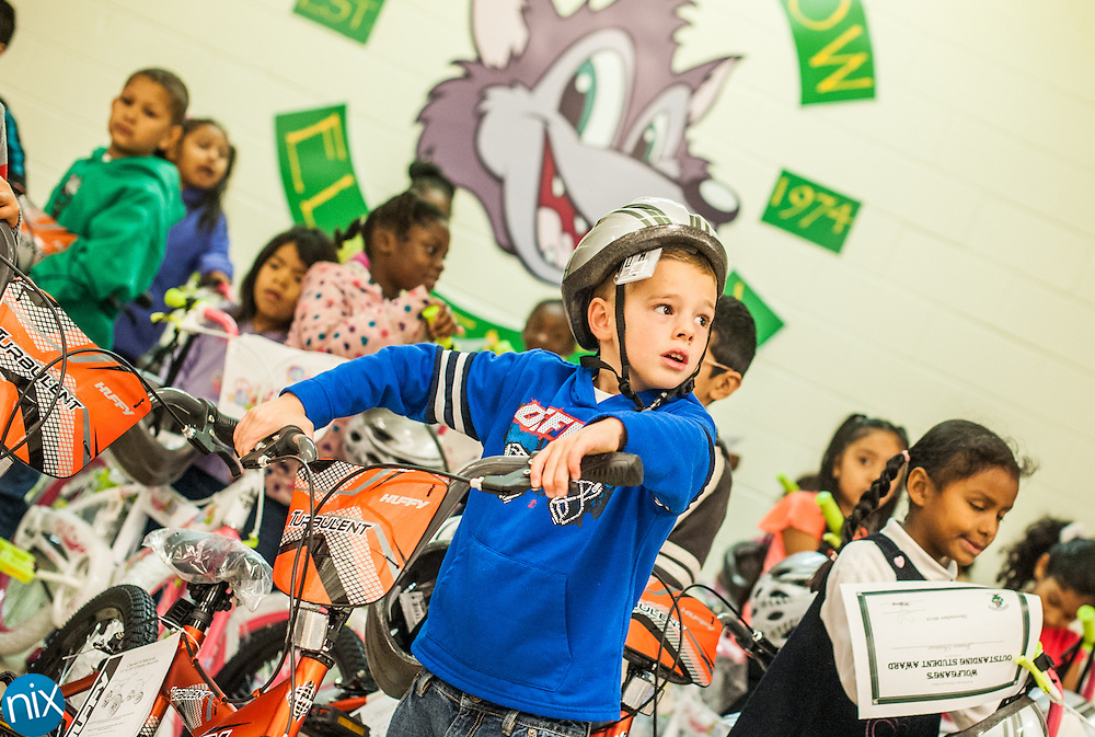 Wolf Meadow Elementary student Michael Dunn tries out his new bike. Students who have improved their academics, attendance and/or behavior received the bikes donated by Academy Sports+Outdoors during an Outstanding Student Award Ceremony at the School Tuesday morning.