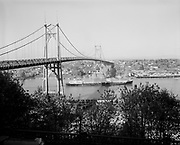 "Ackroyd 06318-1. ""Steamships under St. Johns Bridge. april 24, 1956"", ""Bennington, tanker, Steeb & Col Keystone SS Co."""