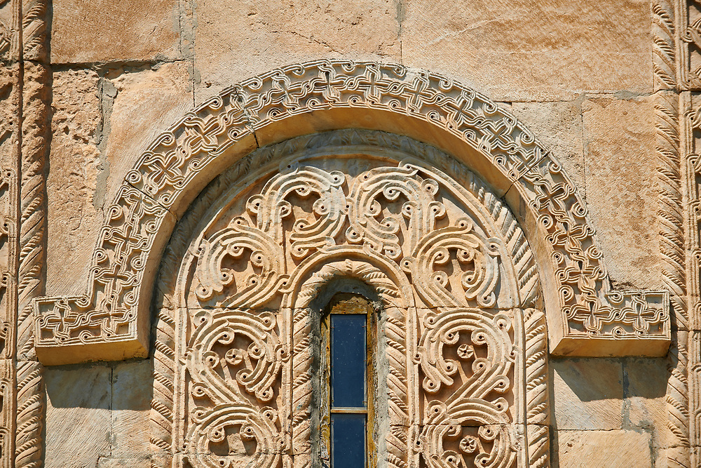 Pictures & images of Nikortsminda ( Nicortsminda ) St Nicholas Georgian Orthodox Cathedral exterior and its Georgian relief sculpture stonework window decorations, 11th century, Nikortsminda, Racha region of Georgia (country). A UNESCO World Heritage Tentative Site.