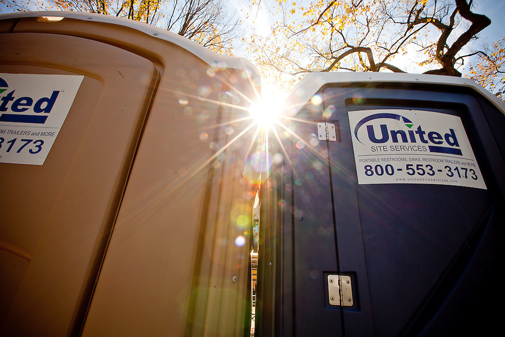 Let the mid-day sun blind you as you enter the port-a-potty.  For your own sake, you probably won't want to see too well once you get inside.