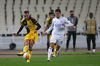 ATHENS, GREECE - OCTOBER 29: Nenad Krstičićof AEK Athens attacks in front of Cengiz Ünderof Leicester City during the UEFA Europa League Group G stage match between AEK Athens and Leicester City at Athens Olympic Stadium on October 29, 2020 in Athens, Greece. (Photo by MB Media)