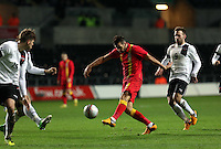 Pictured: Joseph (Joe) Ledley of Wales (C) takes a shot off target. Wednesday 06 February 2013..Re: Vauxhall International Friendly, Wales v Austria at the Liberty Stadium, Swansea, south Wales.