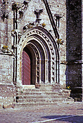Ancient carved stonework arched doorway of church or cathedral, Brittany, France 1974 location not known.