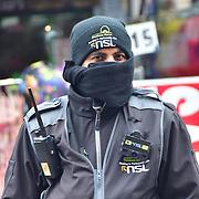 A Security Man During the coronavirus in UK lockdown, at Walthamstow Market, London.