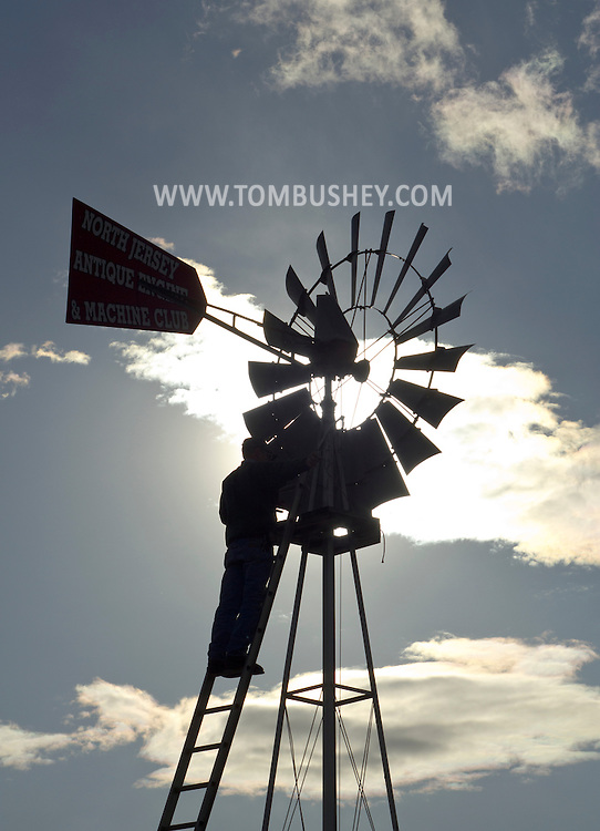 Augusta, New Jersey - A man works on a windmill on display at the North Jersey Antique Engine and Machine Club site at the Sussex County Fairgrounds on May 10, 2012.