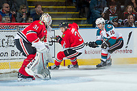 KELOWNA, CANADA - APRIL 8: Nick Merkley #10 of the Kelowna Rockets stick checks Caleb Jones #3 as he skates behind the net of Cole Kehler #31 of the Portland Winterhawks on April 8, 2017 at Prospera Place in Kelowna, British Columbia, Canada.  (Photo by Marissa Baecker/Shoot the Breeze)  *** Local Caption ***