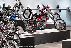 """Josh Sheehan's Buzzards Luck is custom Frisco-style chopper in the front and a race bike in the rear. Built with a customized 1936 VL Frame and a 1947n 45"""" Flathead bottom and 1953 K Model top end. On view in the What's the Skinny Exhibition (2019 iteration of the Motorcycles as Art annual series) at the Sturgis Buffalo Chip during the Sturgis Black Hills Motorcycle Rally. SD, USA. Friday, August 9, 2019. Photography ©2019 Michael Lichter."""