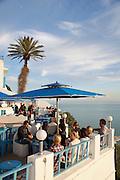 People sitting on terrace overlooking Gulf of Tunis, Sidi Bou Said, Tunisia
