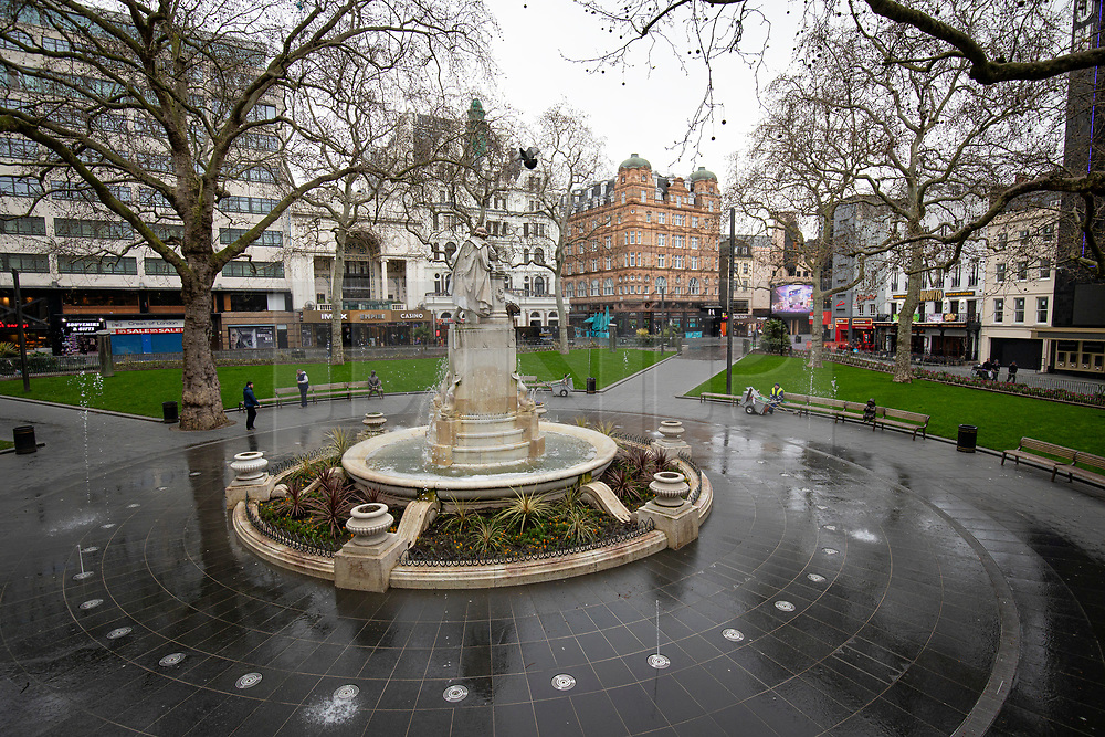 © Licensed to London News Pictures. 19/03/2020. London, UK. A street cleaner takes a break on a bench in a quiet Leicester Square as the Coronovirus outbreak escalates in London. The government has announced a series of measures designed to slow the spread of the virus, which is now spreading more rapidly in the capital than in other parts of the country. Photo credit: Rob Pinney/LNP