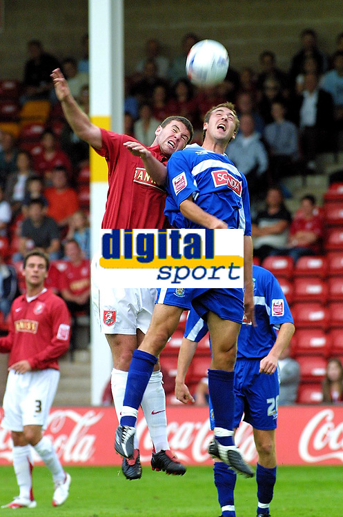 Photo: Dave Linney.<br />Walsall v Stockport County. Coca Cola League 2. 08/08/2006.Walsall's Anthony Gerrard(L) beats   Michael Rose to the ball