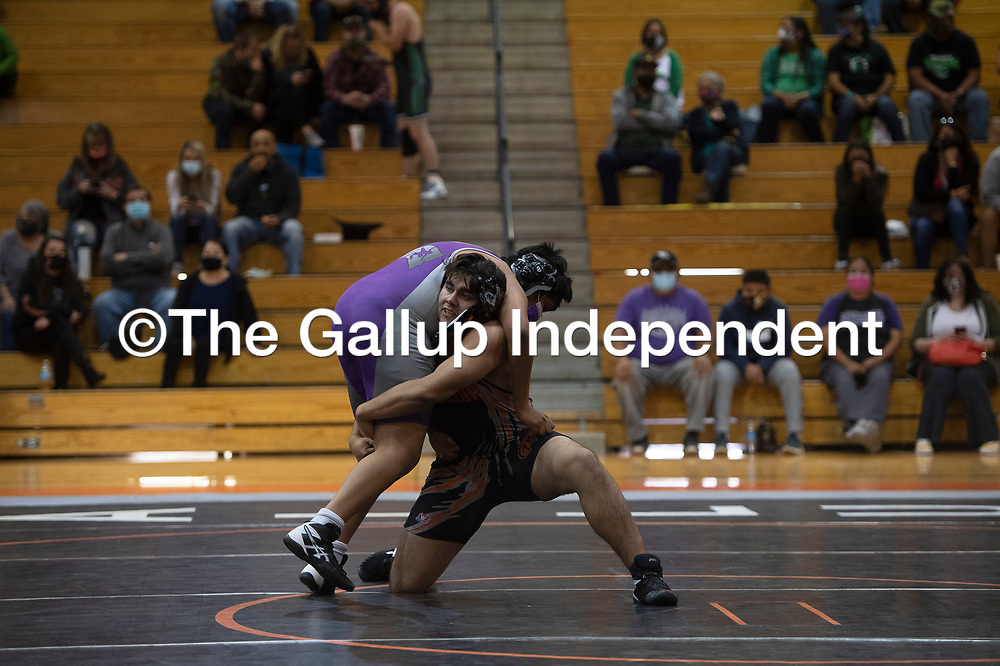Gallup Bengal Shawn Gomez wrestles Miyamura Patriot Dominic Lee Saturday at Gallup High School in Gallup at the Duel in the Dunes wrestling tournament.