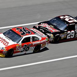 April 17, 2011; Talladega, AL, USA; NASCAR Sprint Cup Series driver Kevin Harvick (29) drafts Dave Blaney (36) during the Aarons 499 at Talladega Superspeedway.   Mandatory Credit: Derick E. Hingle