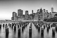 Monochrome overlook of New York City from Brooklyn Bridge Park.