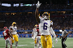 Terrace Marshall Jr. #6 of the LSU Tigers reacts to a touchdown during the first half against the Oklahoma Sooners in the 2019 College Football Playoff Semifinal at the Chick-fil-A Peach Bowl on Saturday, Dec. 28, in Atlanta. (Jason Parkhurst via Abell Images for the Chick-fil-A Peach Bowl)