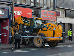 Thieves used a JCB digger to try and steal a cash machine from the wall of a shop in Gorgie Road, Edinburgh in the early hours of Thursday. They fled the scene.<br /> <br /> © Dave Johnston / EEm