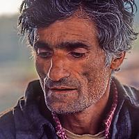 A Kashmiri man relaxes in  Srinigar, Kashmir, India.