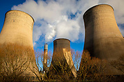 Smoke and steam bellows from the chimneys and cooling towers of Ratcliffe-on-Soar coal fired power station, owned and operated by Uniper at Ratcliffe-on-Soar in Nottinghamshire, England. The plant emits 8–10 million tonnes of CO2 annually. It has a generating capacity of 2,116 MW,  enough electricity to meet the needs of approximately 2 million homes.