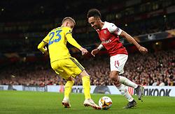 BATE Borisov's Zakhar Volkov (left) and Arsenal's Pierre-Emerick Aubameyang battle for the ball