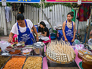 07 APRIL 2013 - CHIANG MAI, CHIANG MAI, THAILAND:  Thai meat snacks for sale at the Walking Street Market. The Walking Street Market starts at Thapae Gate and runs along the length of Ratchadamnoen Road through the heart of the Old City and has become a Chiang Mai institution. Chiang Mai is the largest town in northern Thailand and is popular with tourists and backpackers.       PHOTO BY JACK KURTZ