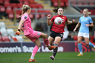 Manchester City goalkeeper Ellie Roebuck (26) clears from the onrushing Manchester United midfielder Kirsty Hanson (18) during the FA Women's Super League match between Manchester United Women and Manchester City Women at Leigh Sports Village, Leigh, United Kingdom on 14 November 2020.