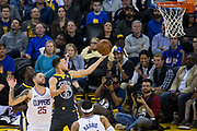 Golden State Warriors guard Stephen Curry (30) takes the ball to the rim against LA Clippers guard Austin Rivers (25) at Oracle Arena in Oakland, California, on February 22, 2018. (Stan Olszewski/Special to S.F. Examiner)