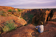Image of woman overlooking canyon in Canyon de Chelly National Monument, Arizona, American Southwest (model released) by Randy Wells