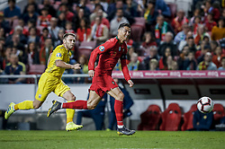 March 22, 2019 - Na - Lisbon, 03/22/2019 - The Portuguese Football Team received their Ukrainian counterpart this afternoon at the Estádio da Luz in Lisbon, in the Group B match in the European 2020 Qualifying Round. Roman Bezus; Cristiano Ronaldo  (Credit Image: © Atlantico Press via ZUMA Wire)