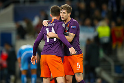 Manchester City's Aymeric Laporte (left) and Manchester City's John Stones celebrate after the final whistle