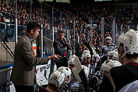 KELOWNA, CANADA - MARCH 16:  Vancouver Giants' head coach Michael Dyck and assistant coach Jeff Bath stand on the bench during a time out against the Kelowna Rockets on March 16, 2019 at Prospera Place in Kelowna, British Columbia, Canada.  (Photo by Marissa Baecker/Shoot the Breeze)