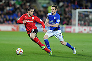 Cardiff city's Craig Conway (l) is challenged by Leicester's Andy King. NPower championship, Cardiff city v Leicester city at the Cardiff city stadium in Cardiff, South Wales on Tuesday 12th March 2013.  pic by  Andrew Orchard, Andrew Orchard sports photography,