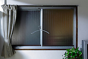 window with curtain and clothing hanger during night