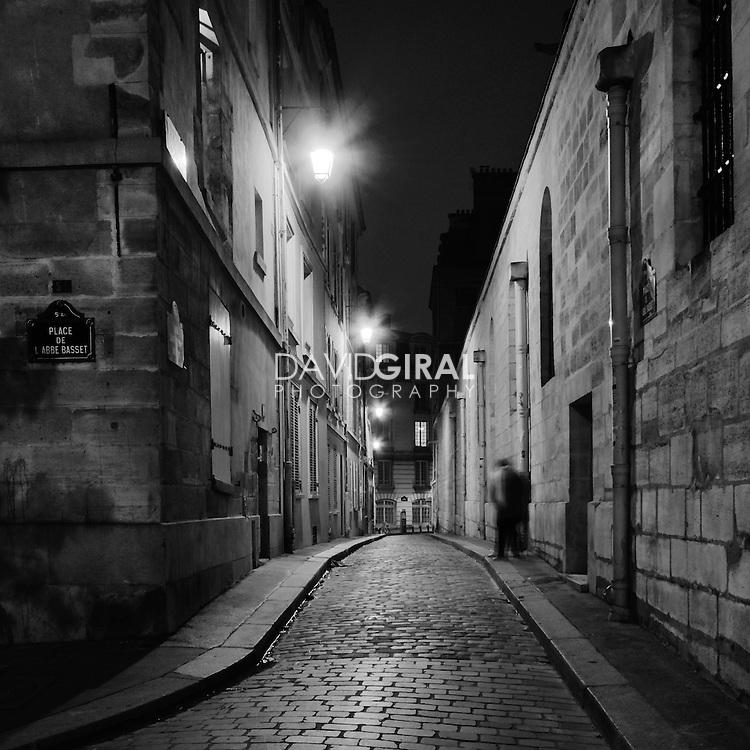 old man walking on Saint-Etienne du Mont Street in Paris, France