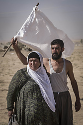 October 21, 2016 - Nineveh Governorate, Iraq - Civilians escape from Khorsabad which is controlled by ISIS and under Peshmerga fire. Peshmerga forces recaptured Khorsabad road. Peshmerga forces are engaging in an operation to attack Islamic State militants in Mosul. (Credit Image: © Bertalan Feher via ZUMA Wire)