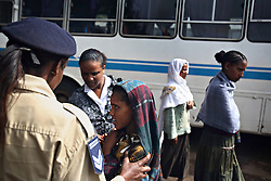 Martha Mengistu and Deputy Sgt. Tiruwork Maimanot intercept a young girl as she comes off the bus at the main bus station in Bahir Dar, Ethiopia on May 28, 2008.  Brokers often look for young girls traveling alone, promising them a good life with lots of money. Often they are trafficked to brothels in exchange for a mere $5. Workers from the Forum for Street Children, a local NGO, have teamed up with the local police to help curb this occurrence, educating brokers about childrens' rights and trying to intercept the girls before they meet the brokers.