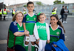 Northern Ireland fans Mildred Singh with her grandchildren Theo and Indi Thompson and mum Alexis Thompson before the international friendly match between Northern Ireland against New Zealand at Windsor Park, Belfast.