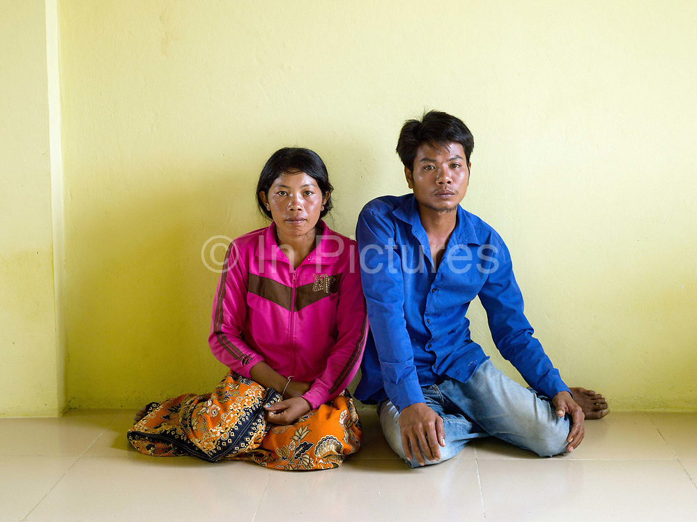 Soo Tou, 29, and wife Ren Way, 26, are from Sre Sronuk Village close to the Sesan River in Streung Treng province, north-eastern Cambodia. 5000 people from 20 villages are being evicted from their homes to make way for a controversial huge new hydropower dam: 'Lower Sesan 2', which will flood an area of more than 33,000 square hectares. The young, newly-married couple accepted the dam company's offer to relocate them in a new concrete house and are among the first few residents of the mostly-empty, half-constructed resettlement site. Communities in this rural region are seeing their traditional self-sufficient farming and fishing lifestyle disrupted by dam building and the impact of climate change on crops, water quality and fish stocks.