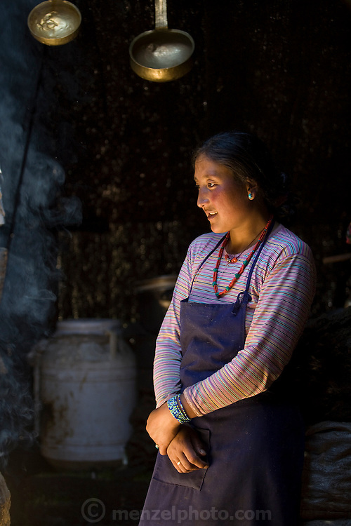 Nomadic yak herder Karsal's wife Phurba in the kitchen of their home in the Tibetan Plateau. (Karsal is featured in the book What I Eat: Around the World in 80 Diets.) MODEL RELEASED.