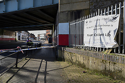 © Licensed to London News Pictures. 24/03/2019. LONDON, UK. Police tape cordons off the area beneath the railway bridge as police attend an address at Marsh Road, Pinner, north west London, after being called at approximately 06:00hrs on 24 March to reports of a man found suffering injuries from a reported stabbing.  He was pronounced dead at the scene by officers and London Ambulance Service.  Enquiries are ongoing, no arrests have yet been made.  Photo credit: Stephen Chung/LNP