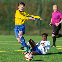 Clare's Charlie Morrisson in action against Waterford's Sultan Adeneka