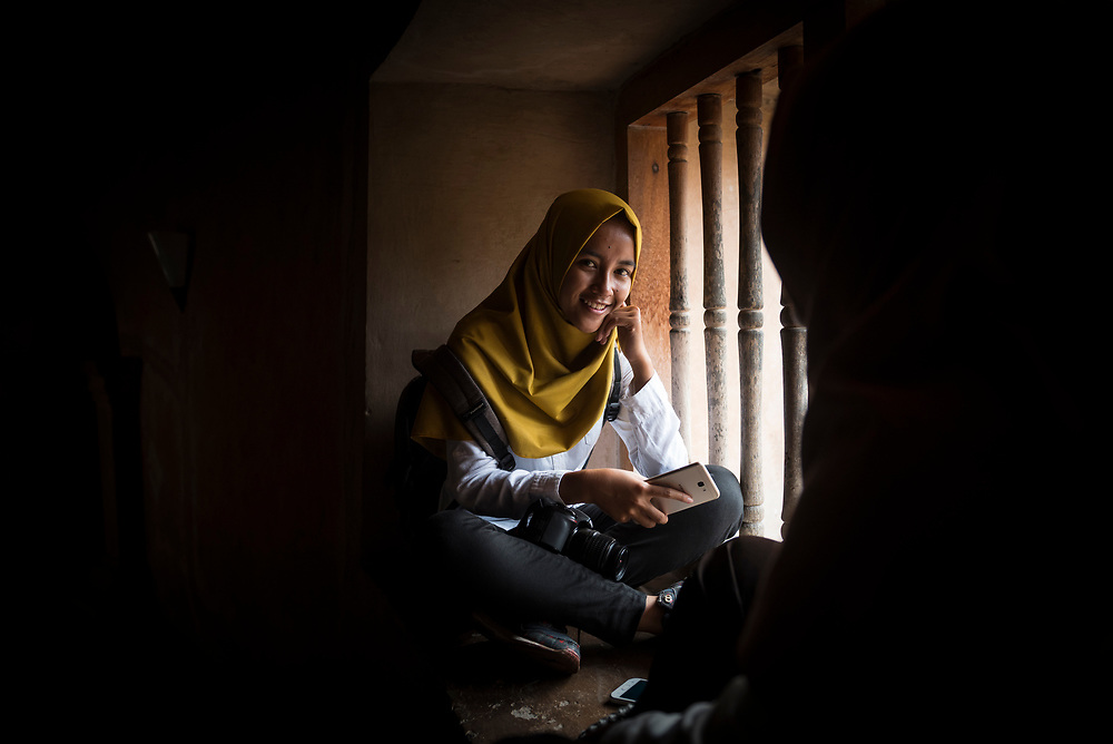 Yogyakarta, Indonesia - March 26, 2017: Annisa, age 17, visits Taman Sari, the site of a former royal garden of the Sultanate of Yogyakarta, on the Indonesian island of Java.