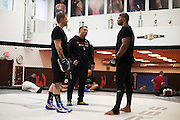 UFC heavyweight Alistair Overeem of The Netherlands visits with striking coach Brandon Gibson and wrestling coach Izzy Martinez after practice at Jackson Wink MMA in Albuquerque, New Mexico on June 9, 2016.