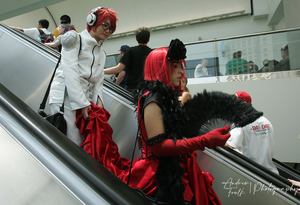 """Andrew Foulk/ Zuma Press.July 24, 2009, San Diego, California, USA. Comic Con. Comic Con attendees use the escalator at the San Diego convention center"""", during day two of the 40th annual San Diego International Comic Con."""