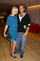 KIMBERLEY STEWART and CALUM BEST at a party to celebrate the launch of Amy Sacco's book 'Cocktails' held at Sanderson, 50 Berners Street, London W1 on 10th July 2006.<br />