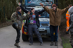 Denham, UK. 11 February, 2020. Environmental activists from Extinction Rebellion, Stop HS2 and Save the Colne Valley 'slow walk' in front of a large truck transporting a JCB forklift truck to a HS2 site at Denham in the Colne Valley. Contractors working on behalf of HS2 are rerouting electricity pylons through a Site of Metropolitan Importance for Nature Conservation (SMI) in conjunction with the high-speed rail link.