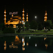 """Night View of the Blue Mosque with special lighting decorated with writing known as mahya for month of Ramadan which is the holly fasting  season for the Muslims. The writing between the minarets reads as """"City of Ramadan"""". The Holly month of ramadan has started on Saturday night in Turkey for the Islam beliewers.  Saturday, 23.09.2006<br /> Photo by Ahmet DUMANLI/TURKPIX"""
