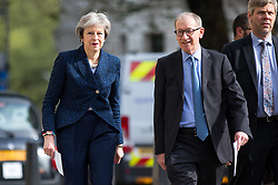 © Licensed to London News Pictures. 03/05/2018. London, UK. British Prime Minister Theresa May and husband Philip May arrive at Methodist Central Hall this morning to vote in the local elections. Photo credit : Tom Nicholson/LNP