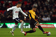 Joss Labadie of Newport County (R) in action with Erik Lamela of Tottenham Hotspur (L). The Emirates FA Cup, 4th round replay match, Tottenham Hotspur v Newport County at Wembley Stadium in London on Wednesday 7th February 2018.<br /> pic by Steffan Bowen, Andrew Orchard sports photography.