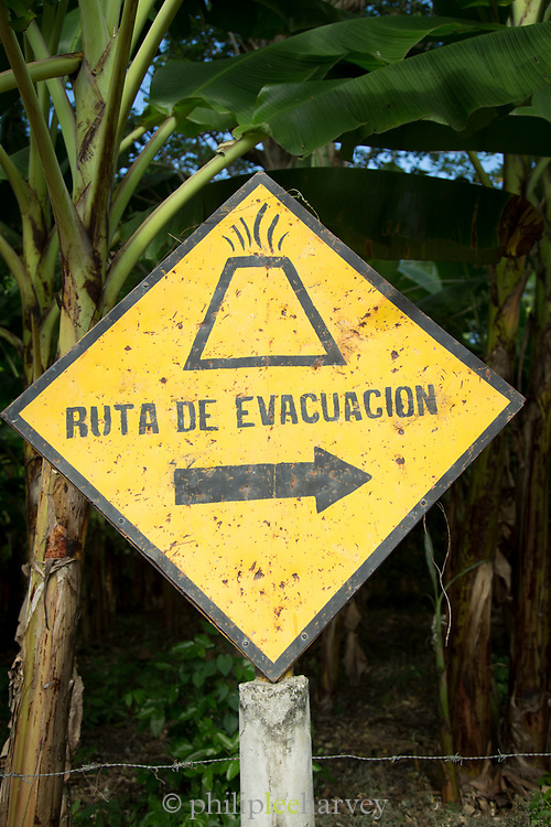 View of a yellow evacuation route sign in case of a volcano eruption, Ometepe Island, Nicaragua