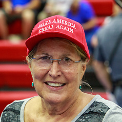 Mechanicsburg, PA – August 1, 2016: A Trump supporter wearing a red Make America Great Again hat before the Donald J Trump political rally.